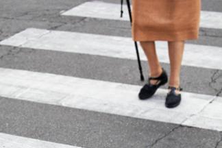 closeup of woman legs at crosswalk
