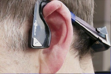close up of a man's left ear with wearable device