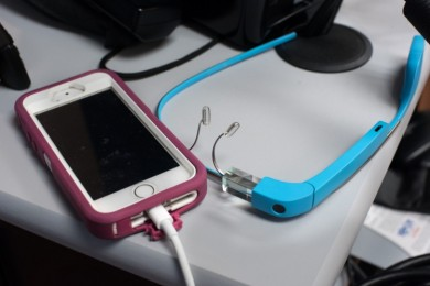 iphone and google glass on table