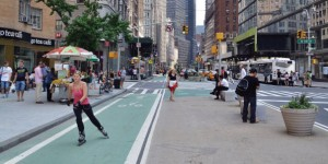 nyc street scape with bike lanes, seating, and multiple amenties for various users