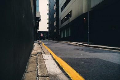 sidewalk that is narrow with broken pavement