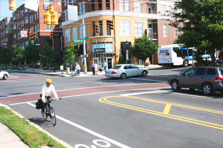 person riding bike in a complete streets setting