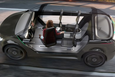 woman sitting leisurely inside autonomous vehicle