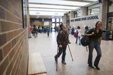 students walking through school corridor