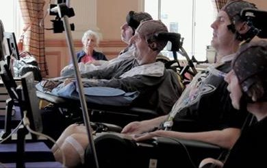 people with disabilities wearing technology that creates music with the power of their minds