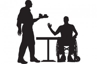 silhouette of a waiter and wheelchair user and table
