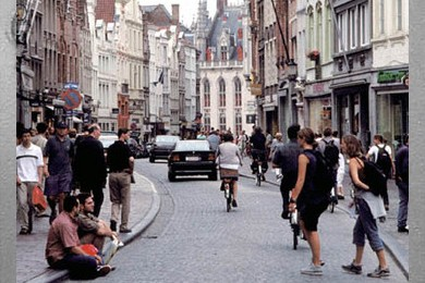 street full of pedestrians on shared street in Brugge, Belgium
