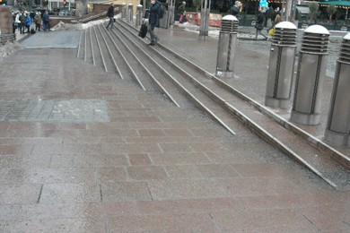 stairs blending in with sloped sidewalk
