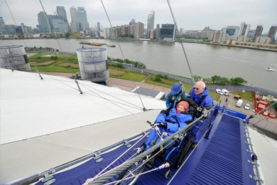 older people on the O2, a walkway suspended across the roof of the venue that offers a climbing experience for visitors