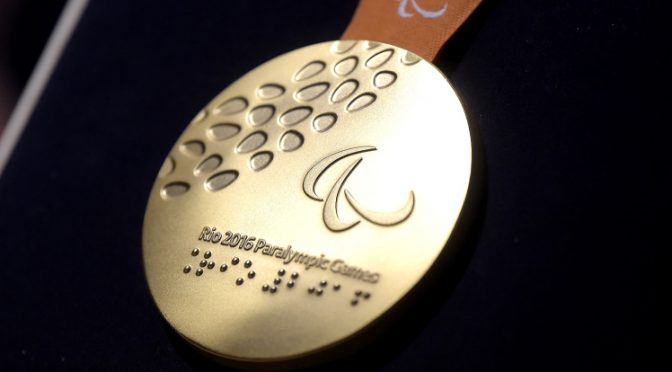 RIO DE JANEIRO, BRAZIL - JUNE 14: A close-up of the gold paralympic medal during the Launch of Medals and Victory Ceremonies for the Rio 2016 Olympic and Paralympic Games at the Future Arena in Olympic Park on June 14, 2016 in Rio de Janeiro, Brazil. (Photo by Alexandre Loureiro/Getty Images)