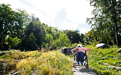 Wheelchair user navigating an outdoor garden at St Olavs Hospital